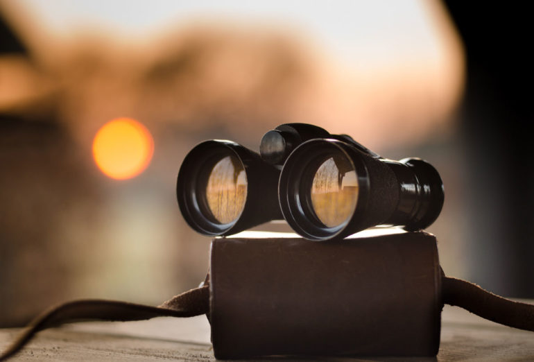 binoculars on a case at sunset